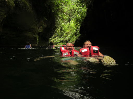 Floating down a pristine river at Millennium Cave, Espiritu Santo, Vanuatu