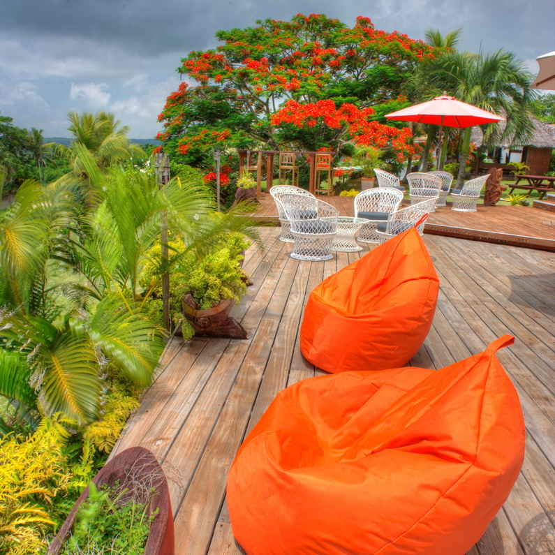 Colourful bean bags by the pool at Deco Stop Lodge