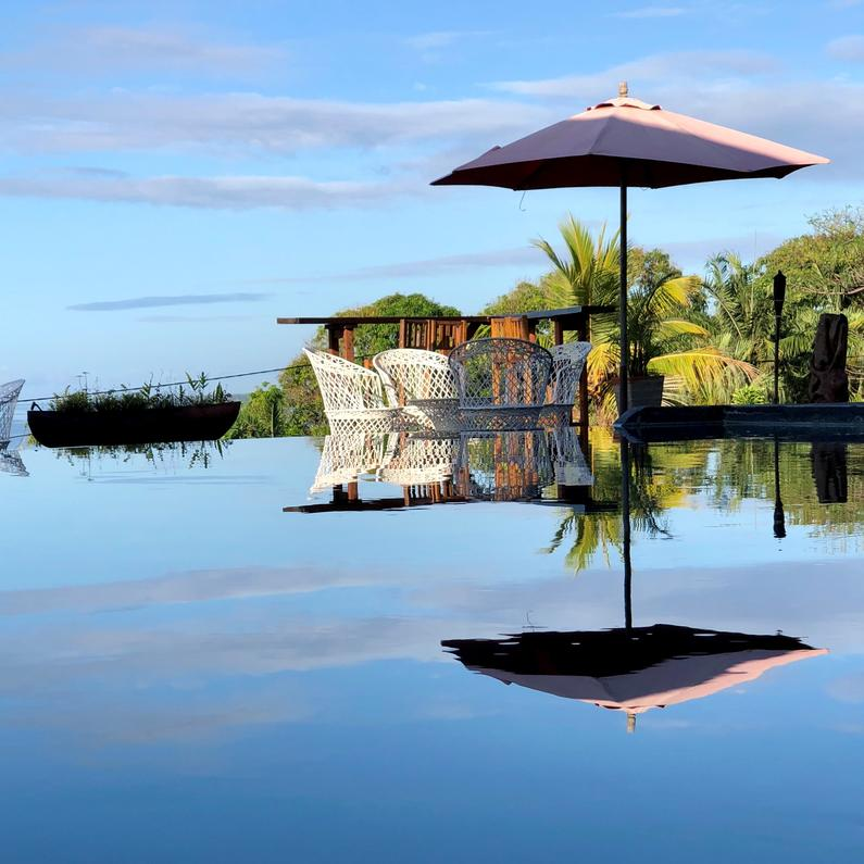 Stunning reflections are a photographer's delight at Deco Stop Lodge's infinity pool