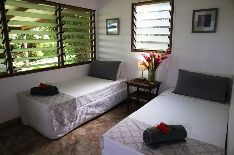 Twin Room configuration in Deluxe Family Two Room Unit at Deco Stop Lodge