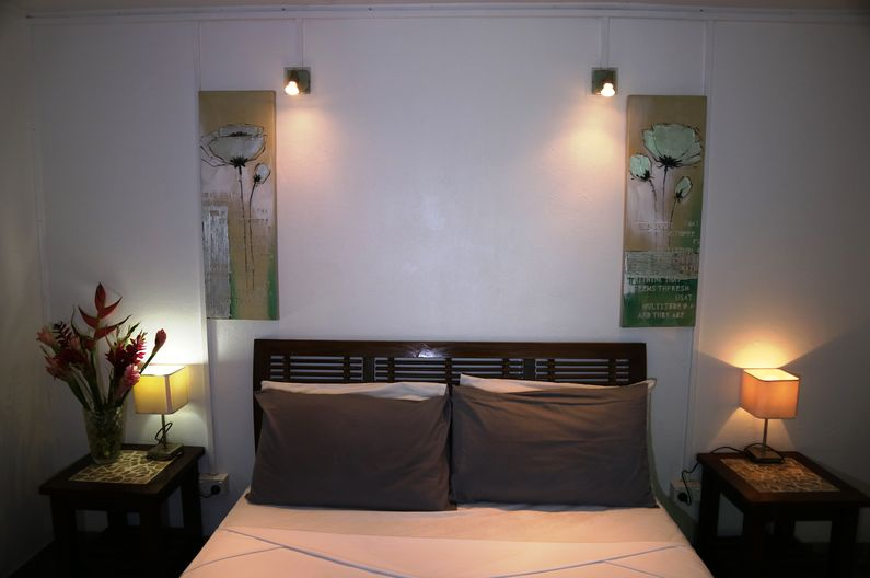 Main bedroom with queen sized bed in Deluxe Family Two Room Unit at Deco Stop Lodge