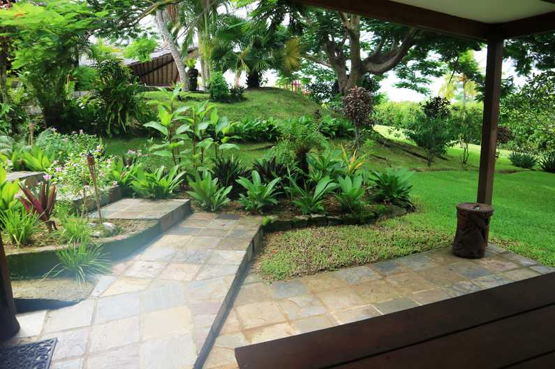 Lush garden view from our Deluxe Family Two Room Unit covered balcony area at Deco Stop Lodge